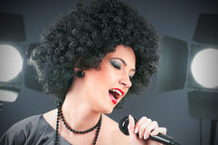 Pop star singing the song. At concert Royalty Free Stock Photo
