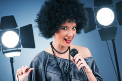 Pop star singing the song Royalty Free Stock Photography