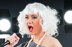 Pop star singing the song Stock Photography