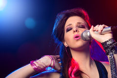 Pop star singing on stage Royalty Free Stock Images