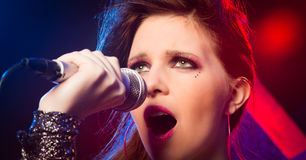 Pop star singing on stage Royalty Free Stock Photography
