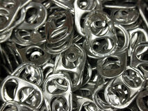 Pop Tabs. A detail of a cluster of pop tabs stock photo