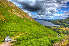 Pop top campervan The Lake District UK with view of british countryside in HDR Royalty Free Stock Photo
