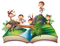Pop-up book with monkeys royalty free illustration
