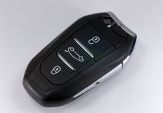 Pop-up car key. Black car key with remote central locking Stock Image