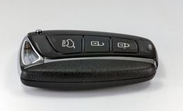 Pop-up car key. Black car key with remote central locking Stock Images