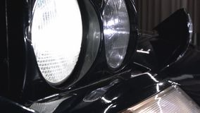 Pop Up Ferrari headlight. A ferrari 400i tun on its pop up headlight, also known as sleepy eyes, in a showroom stock video footage