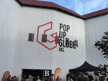 Pop-up Globe Amphitheatre Auckland. AUCKLAND-May 7: Theater goers, fans and spectators at the Pop-up Globe Auckland , a full-scale working temporary replica of Royalty Free Stock Images