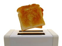 Pop-Up Toast. Golden slices of toast apparently leaping from a pop-up toaster. Isolated over pure white Stock Photography