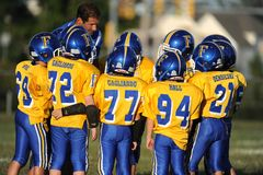 Pop Warner Football arkivbild