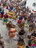 Popayán, Colombia - 5 January 2014 : Black and White Carnival p. View from above of traditional Colombian dancers with colourful costumes and masks in the stock photography