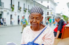 POPAYAN, COLOMBIA - FEBRUARY 06, 2018: Portrait of gorgeous colombian black women smiling and looking somewhere, in the. Streets of Popayan, in Colombia royalty free stock photo