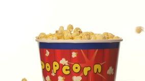 Popcorn που εμπίπτει σε τσάντα, στο λευκό, 2 πακέτο, επιβραδύνει απόθεμα βίντεο