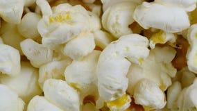 Popcorn το υπόβαθρο περιστρέφεται απόθεμα βίντεο