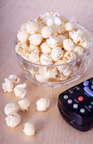 Popcorn. Organic yellow air-popped unsalted unbuttered popcorn and remote stock image