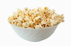 Popcorn. And plate at white Royalty Free Stock Photos