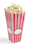 Popcorn. In a colorful, movie type container isolated on a white background Stock Photo