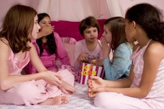 Popcorn. 5 girls at a slumber party enjoying a bucket of popcorn Royalty Free Stock Photography