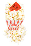 Popcorn. Two tickets in a popcorn container, isolated on white Stock Images