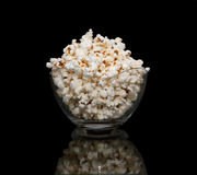 Popcorn. In a glass pot on black background Royalty Free Stock Photos