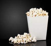 Popcorn. In box on black background Stock Photography