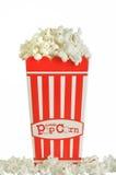 Popcorn. Isolated carton of popcorn on white background Stock Photography