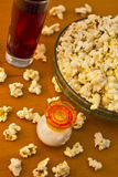 Popcorn. Bowl of freshly made popcorn and juice served on table Royalty Free Stock Photo