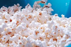 Popcorn. A blue bowl containing fresh popcorn Royalty Free Stock Photo