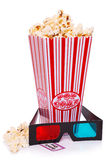 Popcorn, 3D Glasses and Ticket. Box of Popcorn, 3D Glasses and an Admit One ticket on a white background royalty free stock photos