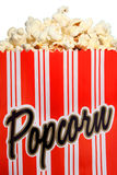 Popcorn. Fresh popcorn in a bag with red stripes royalty free stock photography