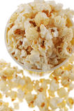 Popcorn. Grains of corn are isolated on a white background royalty free stock photos
