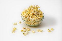 Popcorn. Spread around a glass bowl field with royalty free stock images