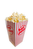 Popcorn. A tall classic box of theater popcorn royalty free stock photography