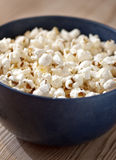 Popcorn. Fresh, buttery popcorn in a blue bowl Stock Photos