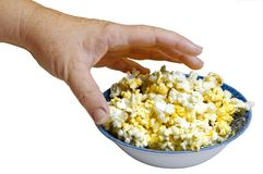 Popcorn 944. A hand grabbing hot buttered popcorn from a bowl Royalty Free Stock Image