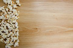 Popcorn arranged on wooden background stock images