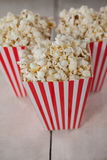 Popcorn arranged on wooden table Stock Image