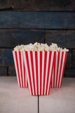 Popcorn arranged on wooden table Stock Photography