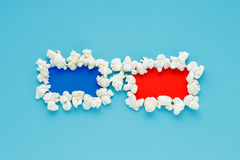 Popcorn art 3d glasses on cyan pastel background. Royalty Free Stock Photo