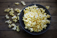 Popcorn in the back bowl on wooden Stock Photography