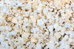 Popcorn Background. Freshly popped and buttered popcorn as a background stock photography
