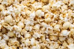 Popcorn background. Caramel sweet corn. Cinema snack. Royalty Free Stock Image