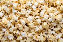 Popcorn background. Caramel sweet corn. Cinema snack. Stock Image