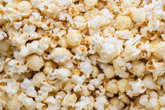 Popcorn background. Caramel sweet corn. Cinema snack. Royalty Free Stock Photography
