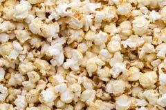 Popcorn background. Caramel sweet corn. Cinema snack. Stock Images