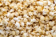 Popcorn background. Caramel sweet corn. Cinema snack. Royalty Free Stock Images