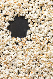 Popcorn background with copy space on dark, black background Royalty Free Stock Photo