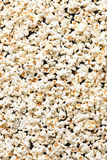 Popcorn background, isolated on black, top view Stock Photos