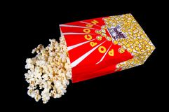 Popcorn Bag and Popcorn. A popcorn bag and popcorn on a black background royalty free stock image