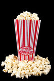 Popcorn in bag with popcorn around Royalty Free Stock Photography